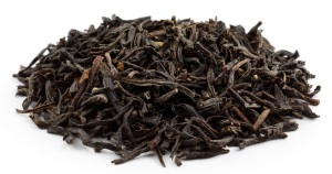 Fully oxidised black tea leaves.