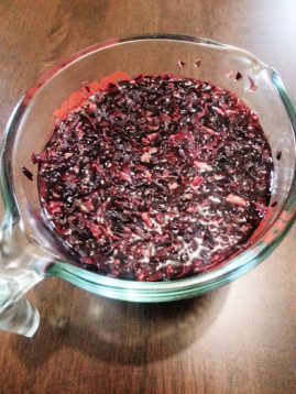 A strong infusion of hibiscus in a small cooking jug